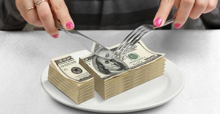 Money cut on plate