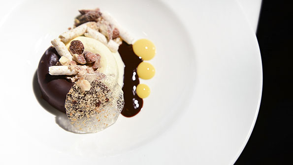 Pastry chef Tracy Obolsky's Almond Joy Ice Cream Cake with Passion Fruit and Warm Fudge Sauce. Photo Credit: Liz Barclay